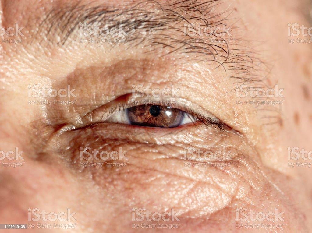 Beautiful eye of a 70 year old man. stock photo