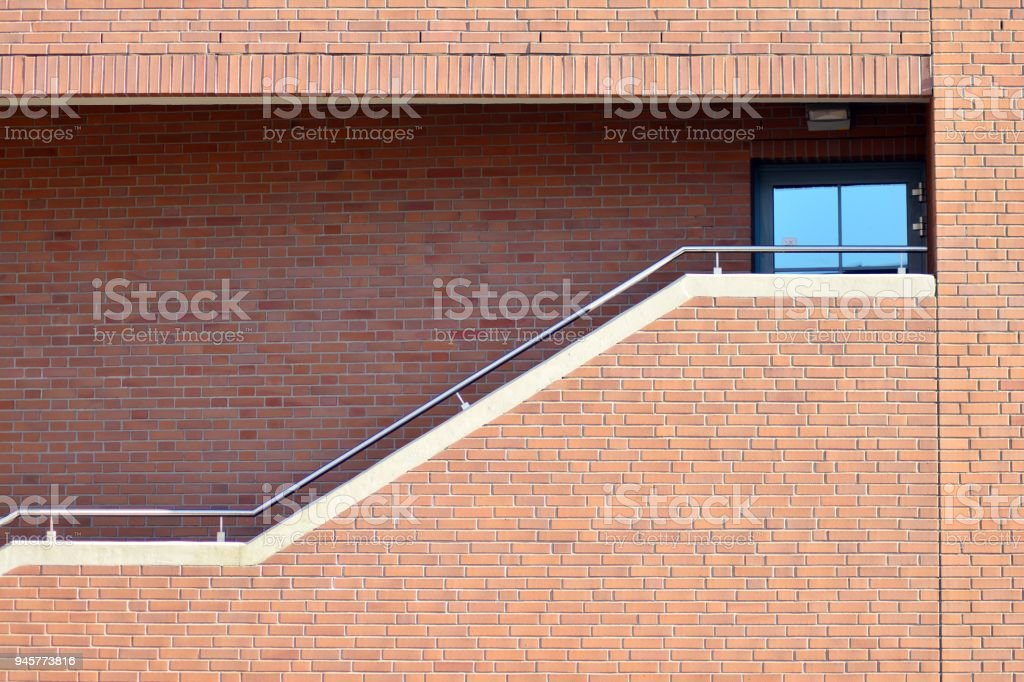 Beautiful facade of a modern office building made of red brick. stock photo