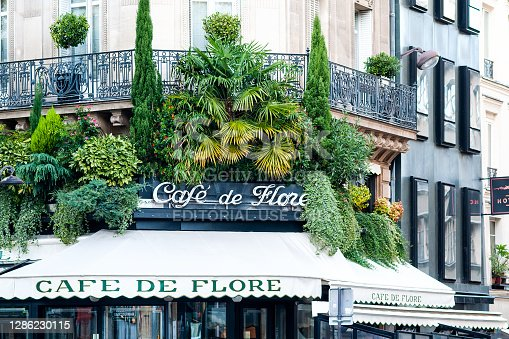 The beautiful Cafe De Flore is one of the oldest cafe in Paris, located in 6th arrondissement, in Saint Germain des Près. It was associated with Jean Paul Sartre, Simone de Beauvoir, Albert Camus, Pablo Picasso... Paris, in France, boulevard Saint Germain. November 9, 2020