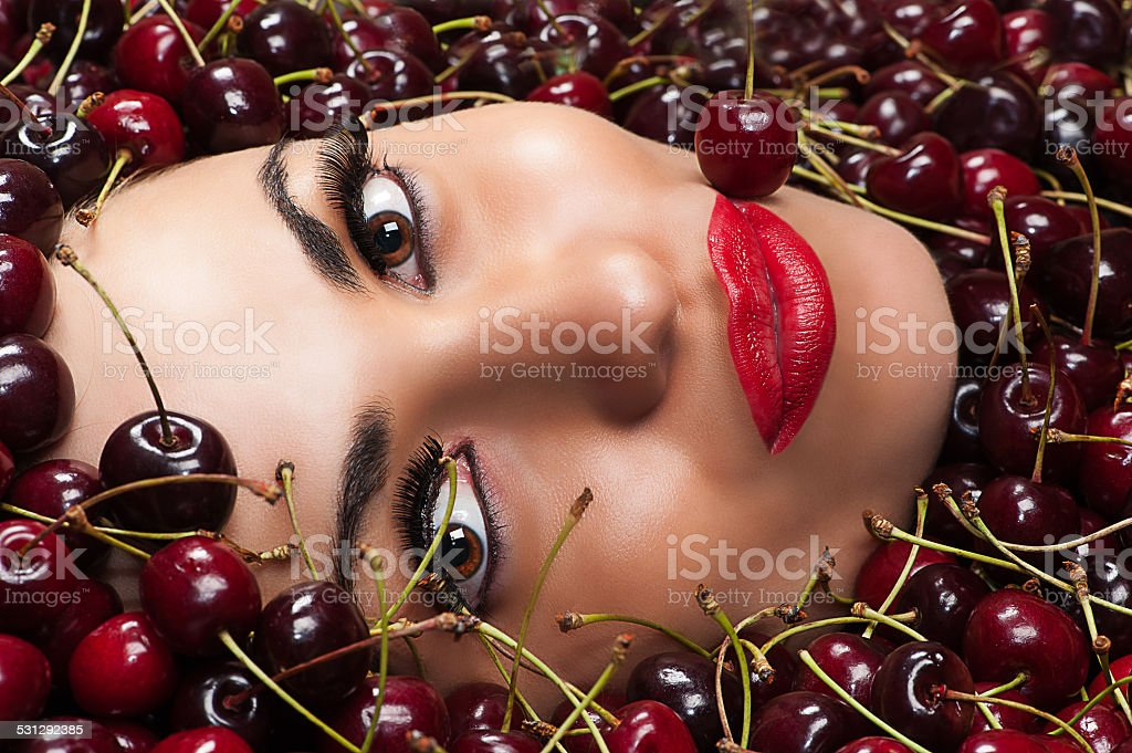 beautiful face in cherry stock photo