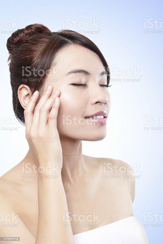 beautiful face of girl applying moisturize cream royalty-free stock photo