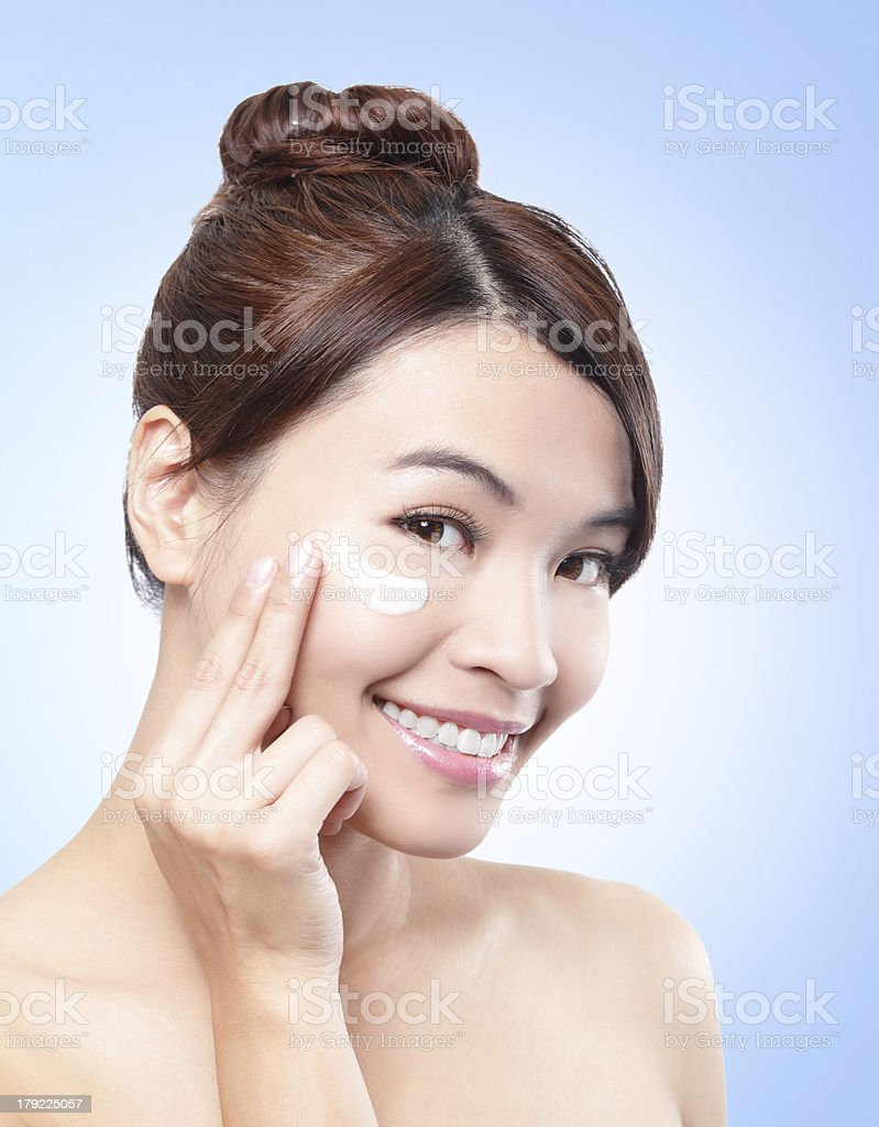 beautiful face of girl applying moisturize cream royalty-free stock photo