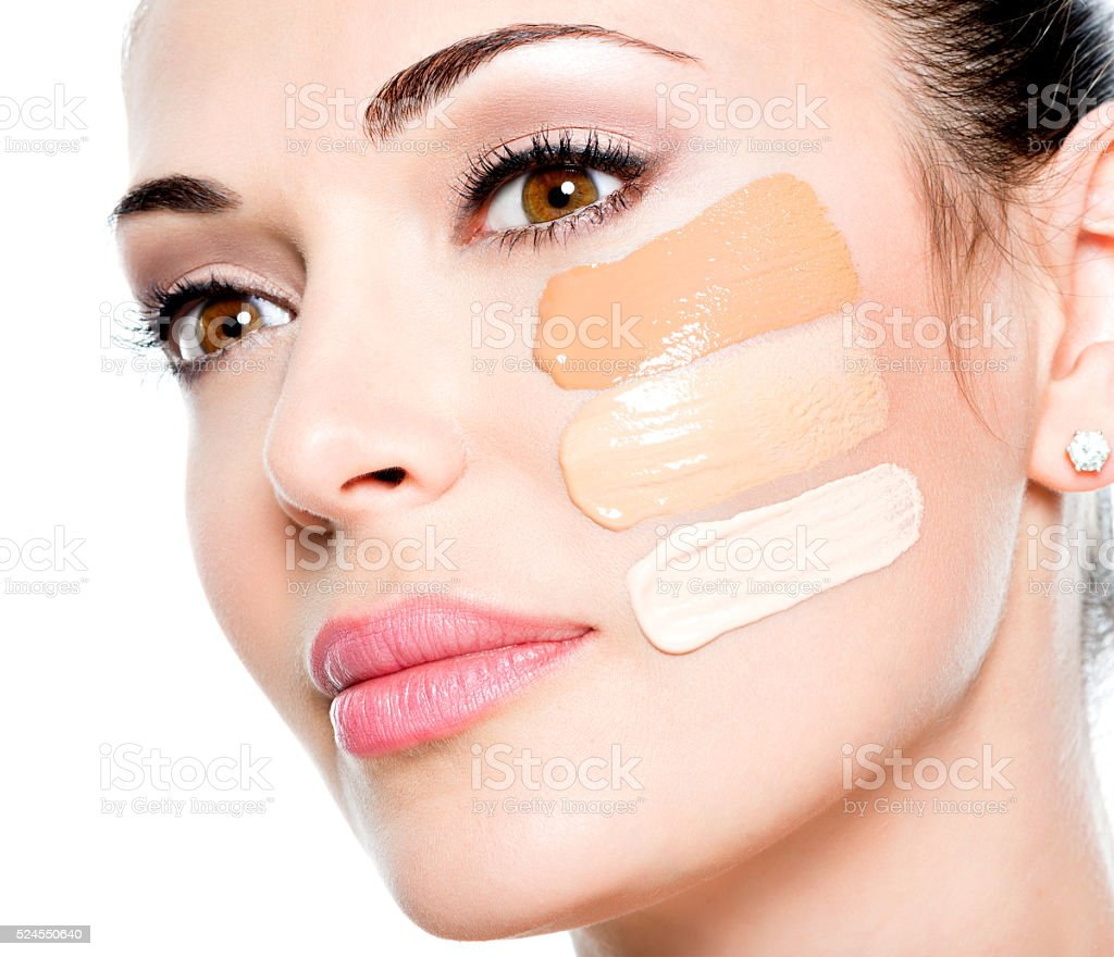 Beautiful face of  woman with cosmetic foundation on a skin stock photo