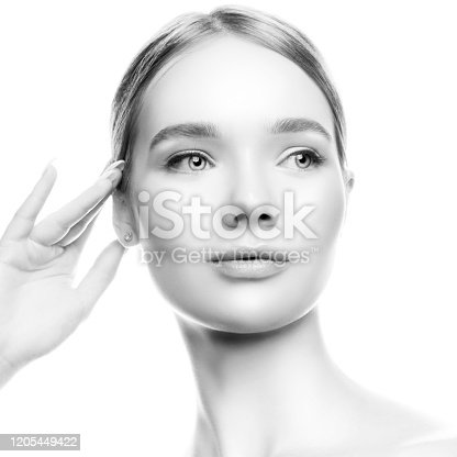Close-up beauty model girl headshot. Natural nude makeup, isolated on white background.