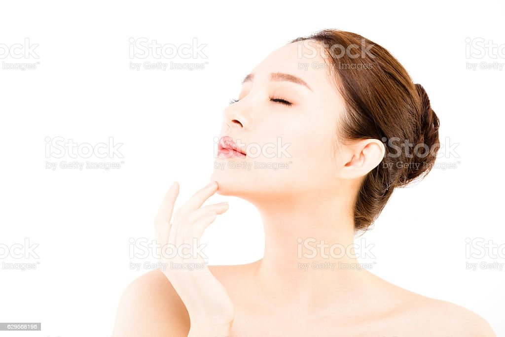 Beautiful face of young  woman with clean fresh skin stock photo