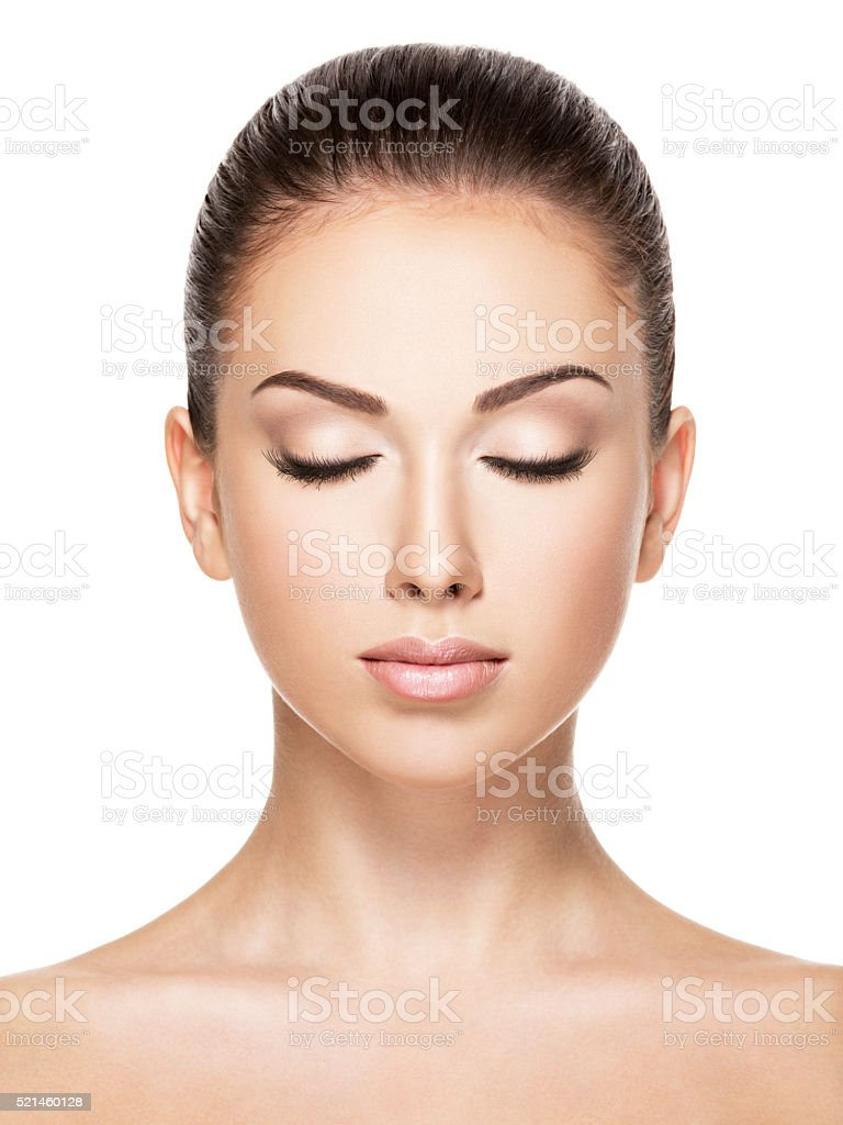 Beautiful face of young woman with closed eyes stock photo