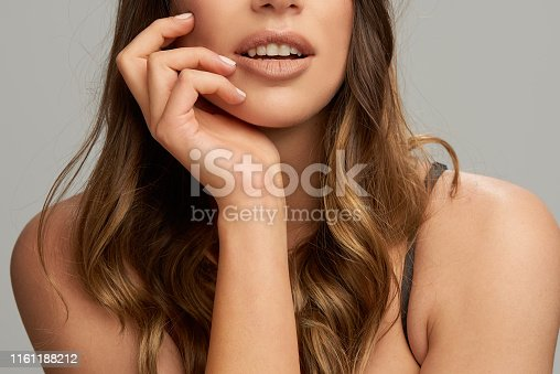 Cut out picture of brunette posing with hand on chin. Beauty photography.