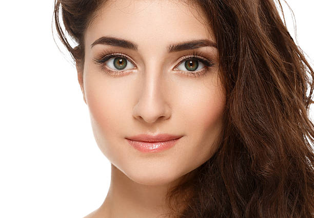 beautiful face of young woman with perfect skin. isolated white. - close to stock photos and pictures