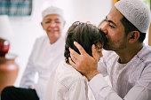istock Beautiful Family Asking For Forgiveness on Hari Raya Aidilfitri/ Eid-Ul-Fitr 1195742550