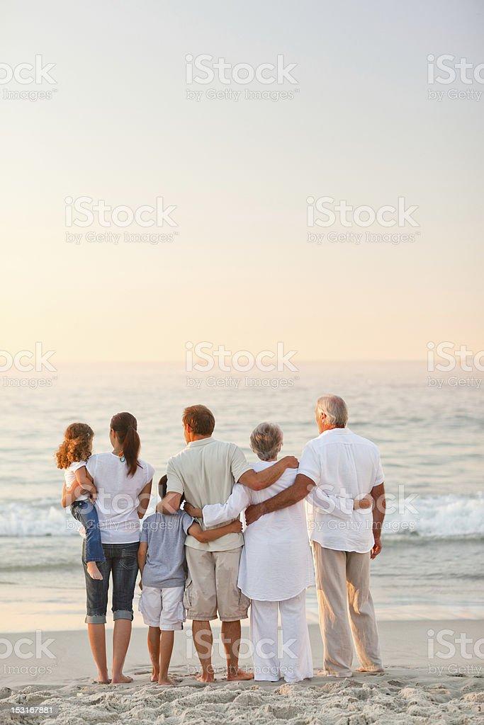 Beautiful family at the beach stock photo