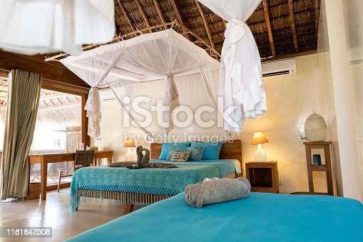Beautiful family hotel room with mosquito nets