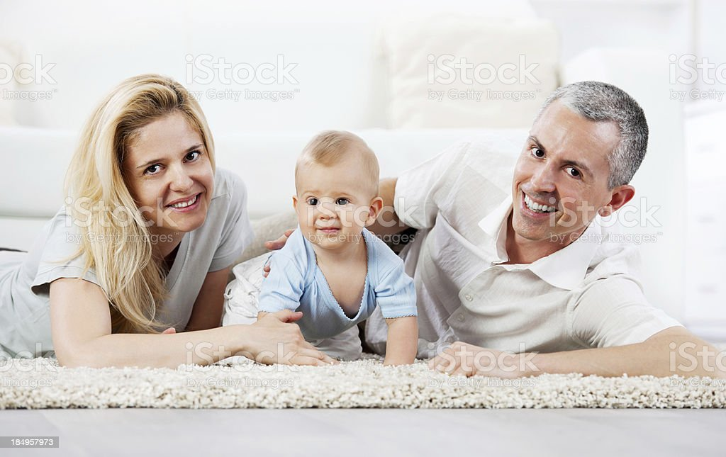 Beautiful family lying on the floor royalty-free stock photo