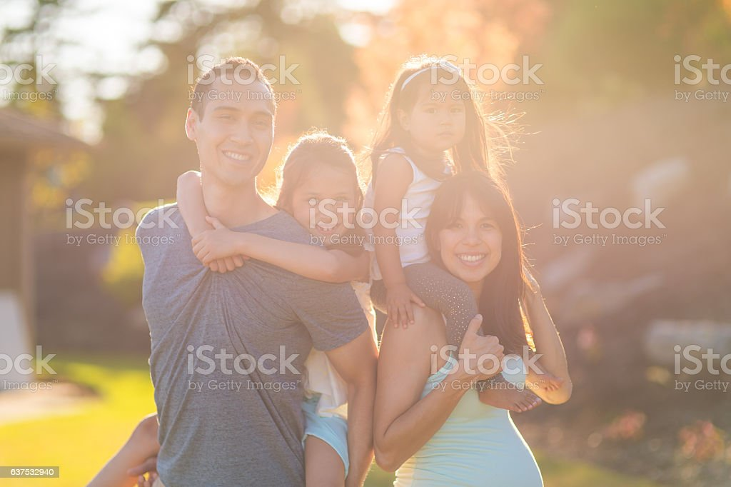 A beautiful ethnic family of four is spending time stock photo