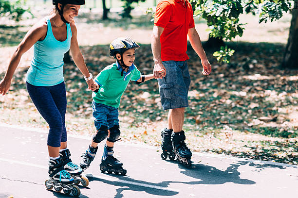 Beautiful family on roller blades stock photo