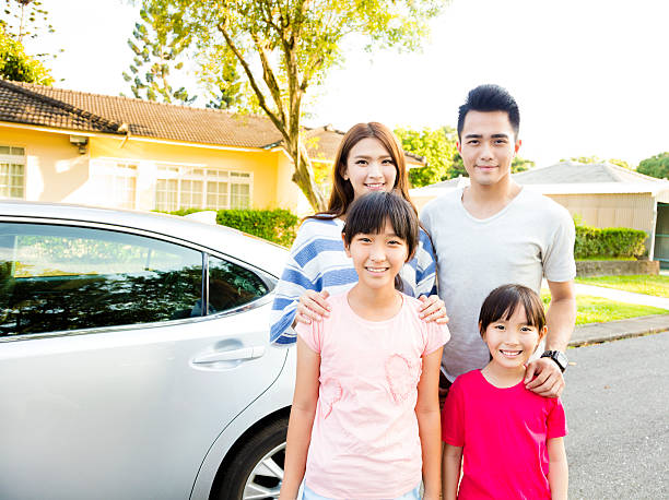 Beautiful family portrait smiling outside their  house stock photo