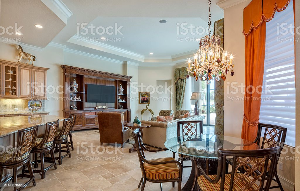 Beautiful Family Room and Dining in Coach Home stock photo
