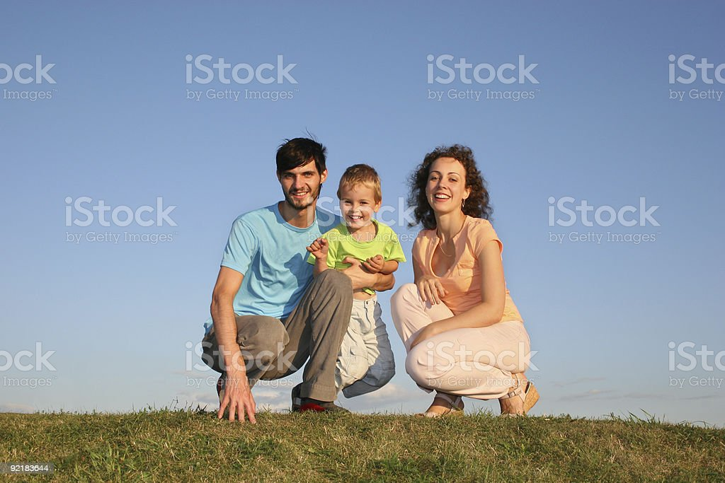 Beautiful family sitting in a meadow royalty-free stock photo