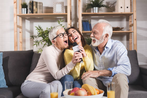 Beautiful family together. Mother, father and daughter smiling and hugging with love at home. stock photo