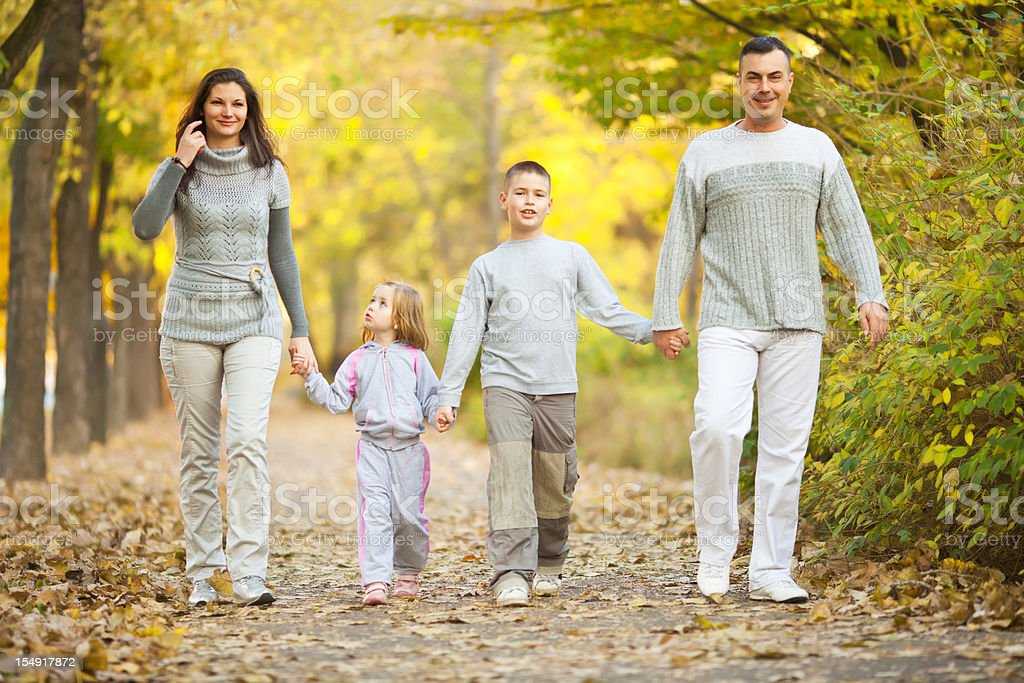 Beautiful family walking at the park. royalty-free stock photo
