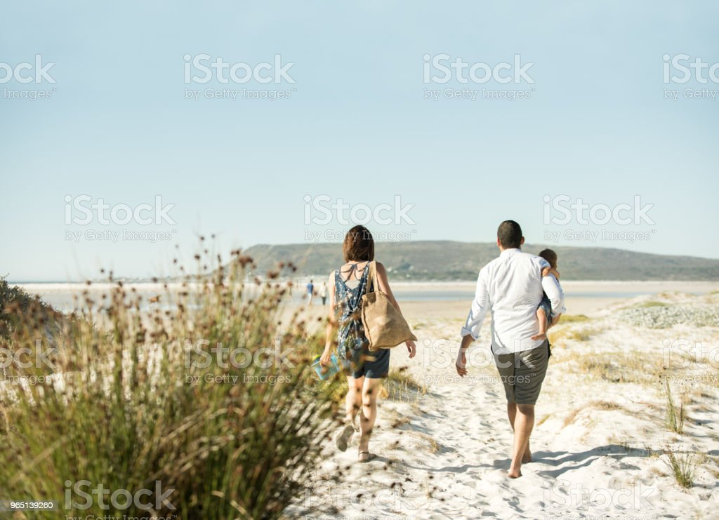 Beautiful family walking on the beach zbiór zdjęć royalty-free