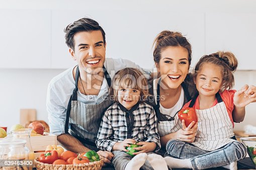 istock Beautiful family with two children 639463400