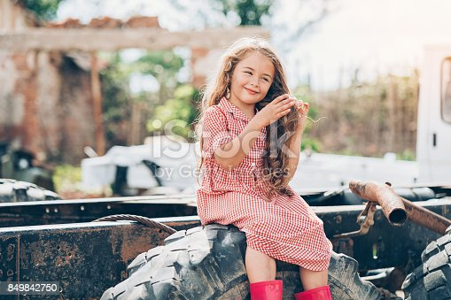 istock Beautiful farm girl making her hair 849842750