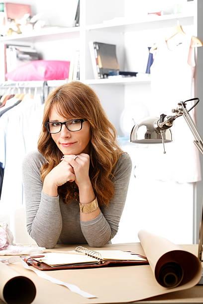 Beautiful fashion designer working in her studio stock photo