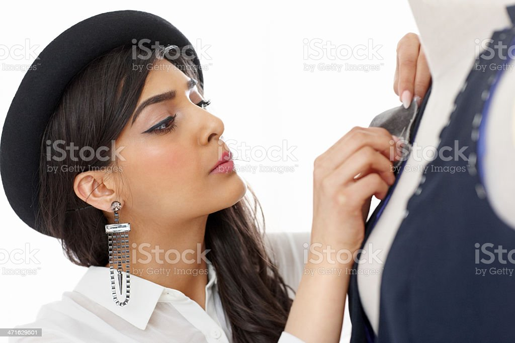 Beautiful fashion designer working on the mannequin royalty-free stock photo