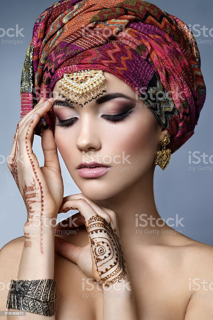 Beautiful fashion east  woman portrait with oriental accessories stock photo