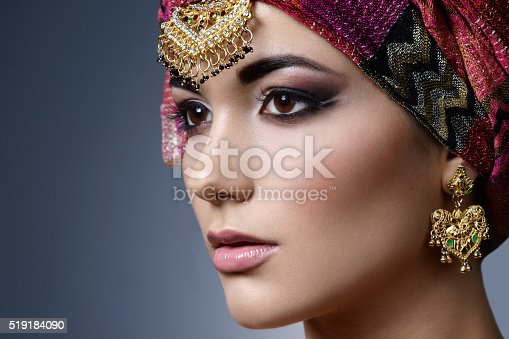 istock Beautiful fashion east  woman portrait with oriental accessories 519184090