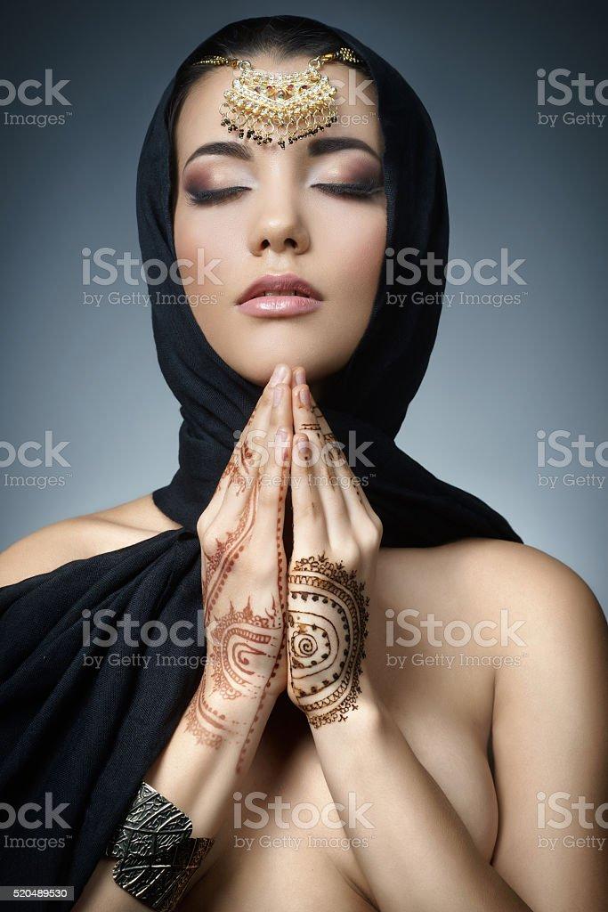 Beautiful fashion east  woman portrait.Asian girl in  black headscarf stock photo