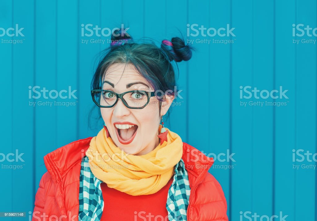 Beautiful Fashion Hipster Woman With Colorful Hair Over Blue