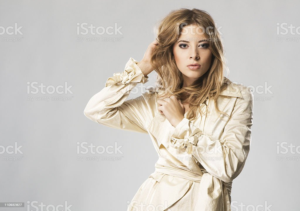 Beautiful fashion model in beige coat royalty-free stock photo