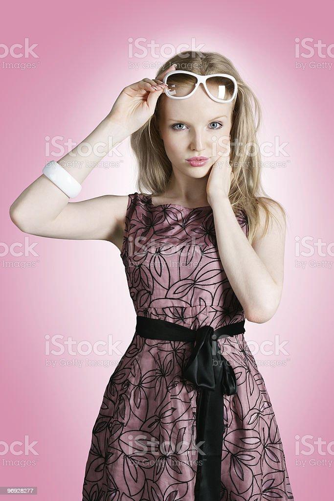 Beautiful fashion model in pink dress royalty-free stock photo