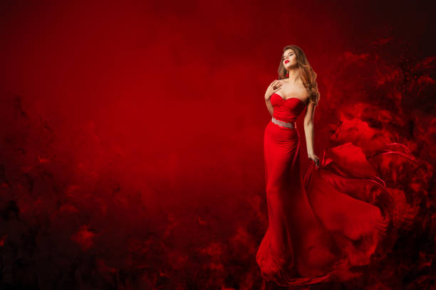 Beautiful Fashion Model in Red Dress, Woman Beauty Portrait, Elegant Lady in Long Sexy Gown stock photo