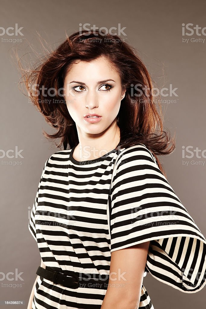 Beautiful fashion model posing looking over her shoulder royalty-free stock photo