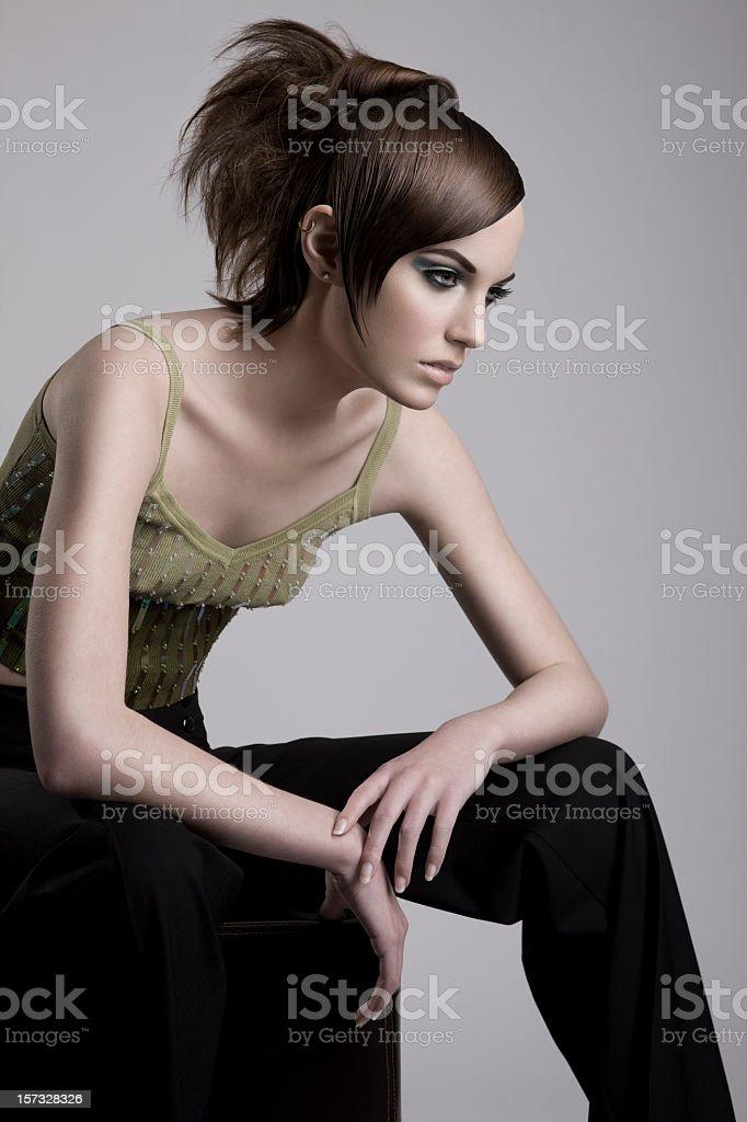 Beautiful Fashion Model Sitting Like a Mannequin royalty-free stock photo