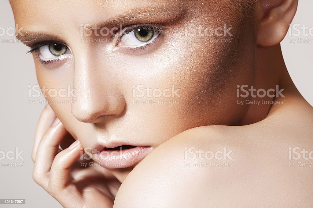 Beautiful fashion model with bronze tanned make-up stock photo