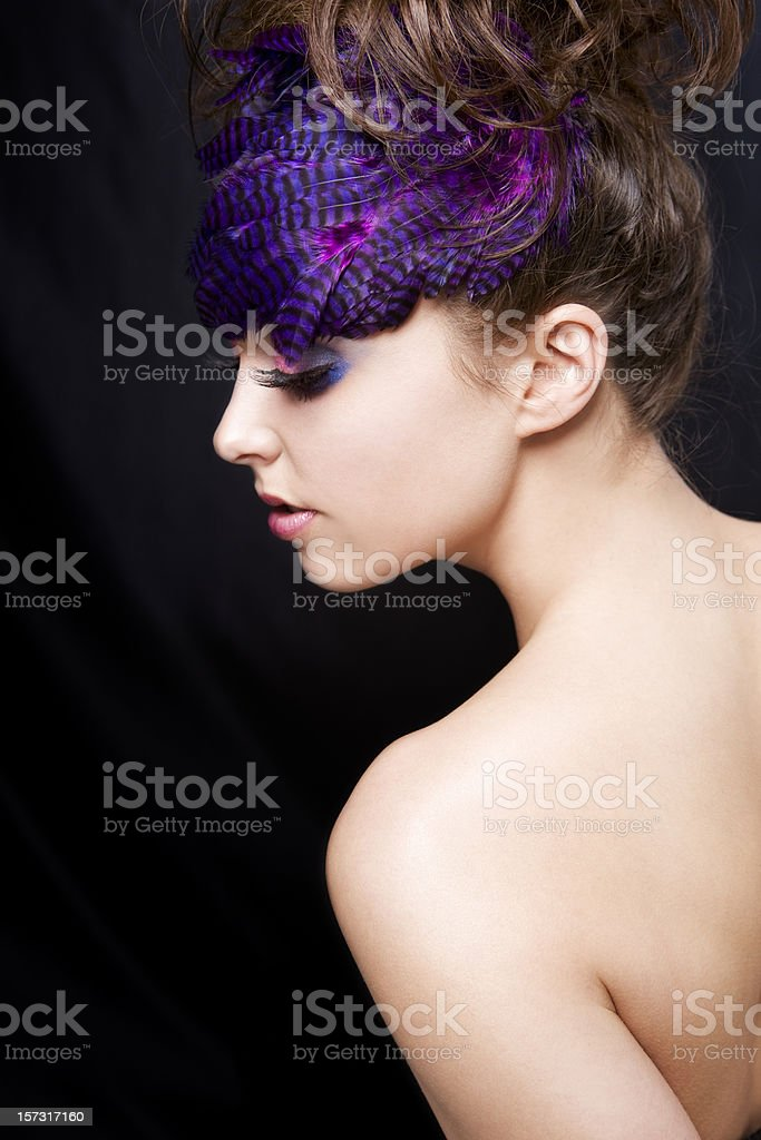 Beautiful Fashion Model with Feathers in Hairstyle and Colorful Makeup royalty-free stock photo