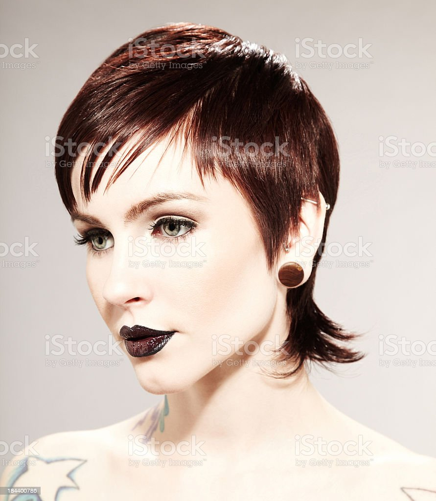 Beautiful fashion model with tattoos wearing black lipstick royalty-free stock photo