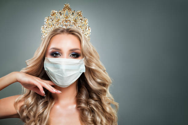 beautiful fashion model woman in medical face mask and diamond crown - diadem stock pictures, royalty-free photos & images