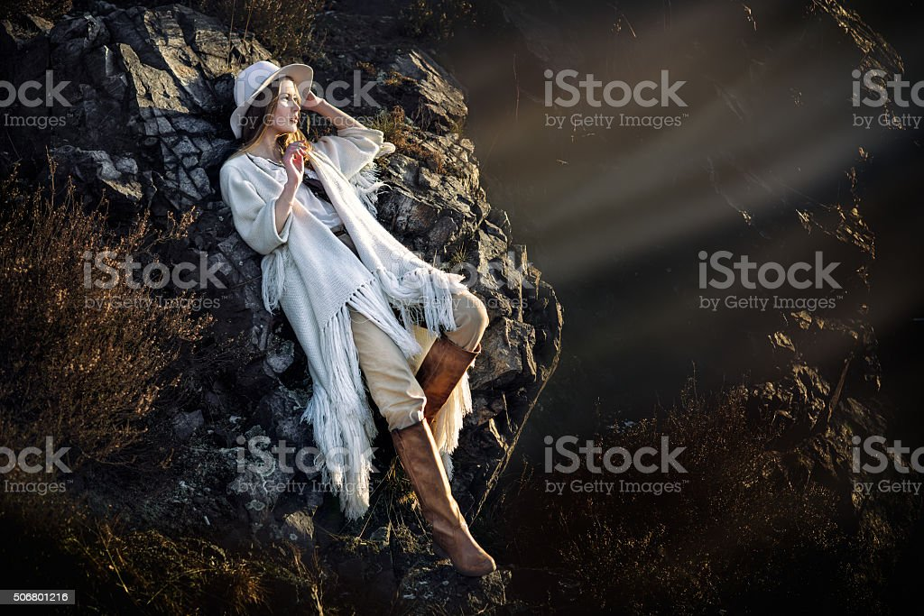 Beautiful fashion model woman posing in mountains at sunset time stock photo