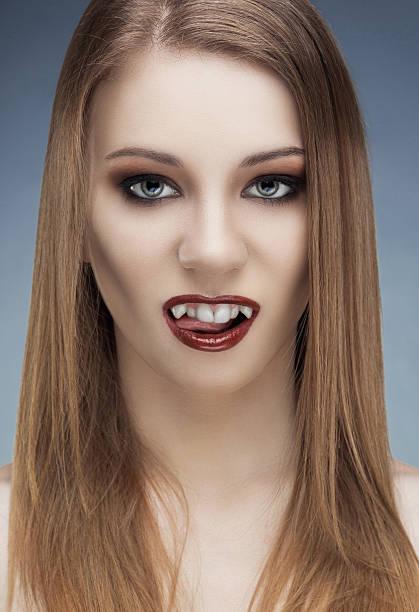 beautiful fashion models portrait with fancy makeup - vampir schminken frau stock-fotos und bilder