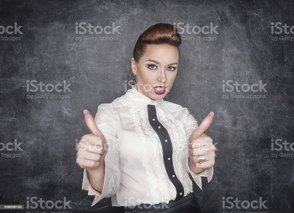 Beautiful fashion woman showing thumbs up sign royalty-free stock photo