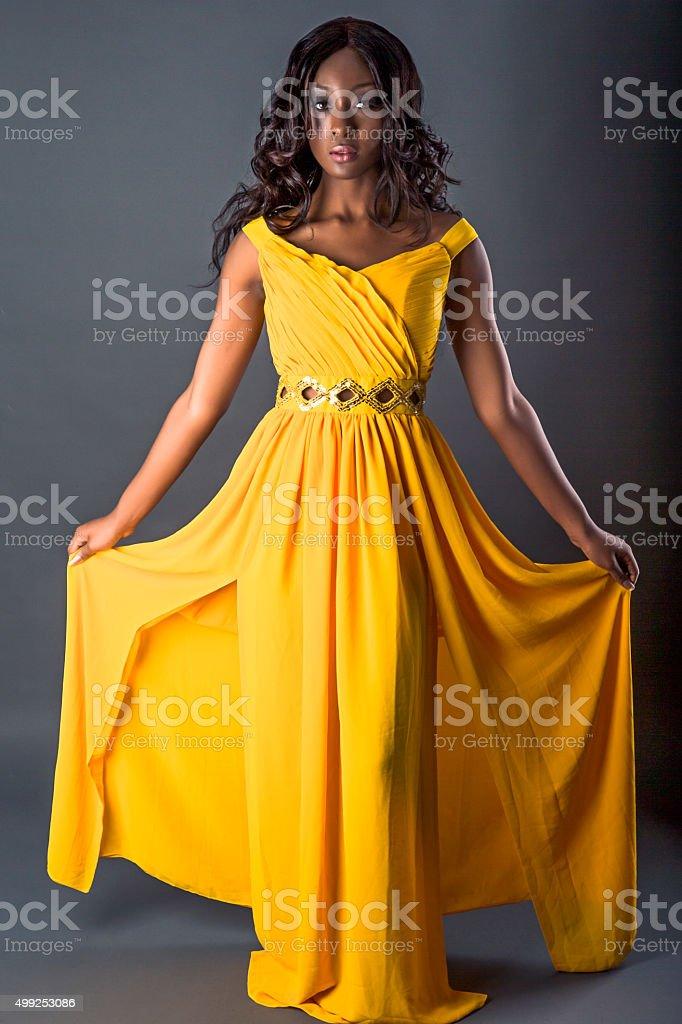 Beautiful fasion model in yellow gown stock photo