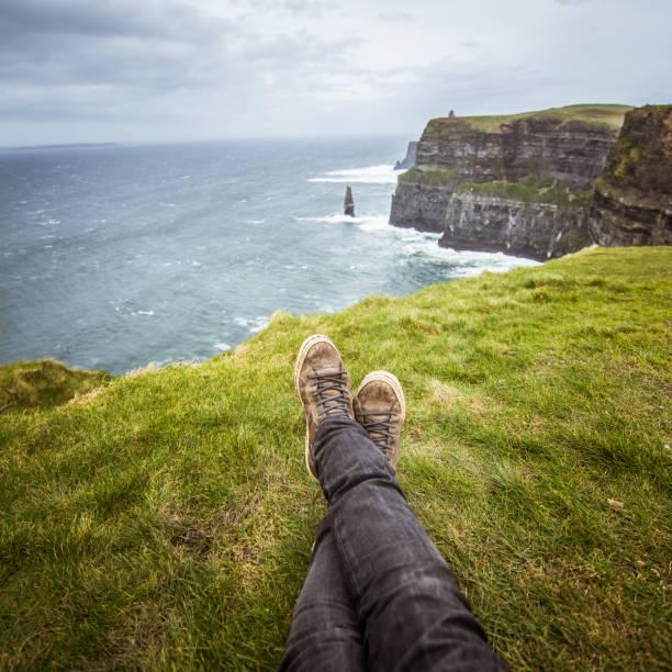 A beautiful feet selfie at the coast of Atlantic ocean in Ireland. stock photo