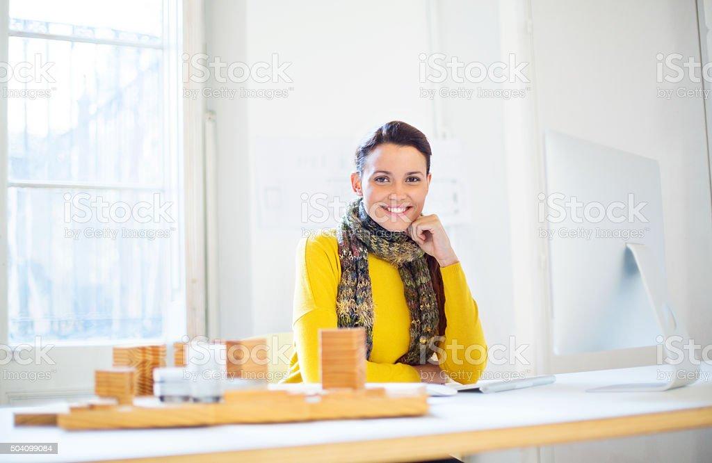 Beautiful female architect at work stock photo
