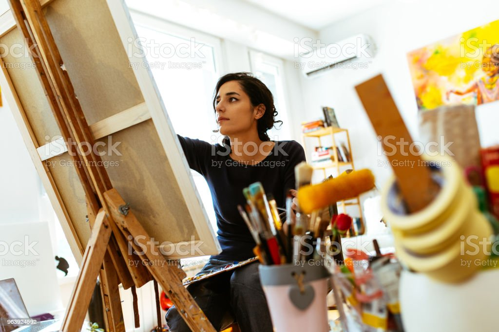 Beautiful female artist painting on a canvas with brush and palette - Royalty-free 20-29 Years Stock Photo