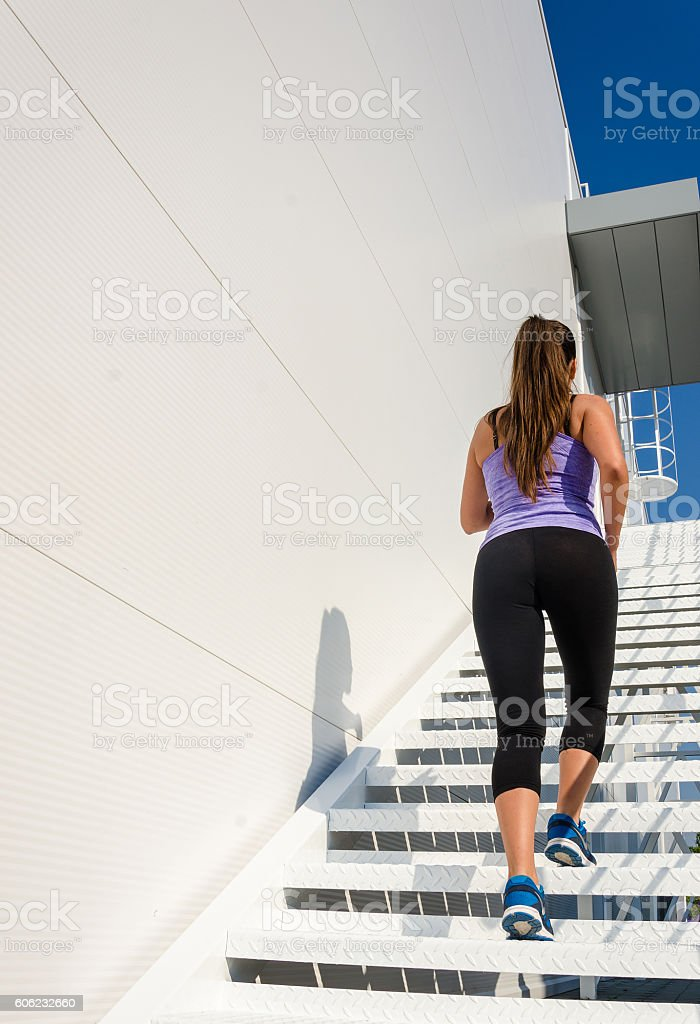 Beautiful female athlete running stock photo