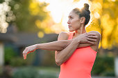 istock Beautiful female athlete stretching before outdoor workout 1287983452